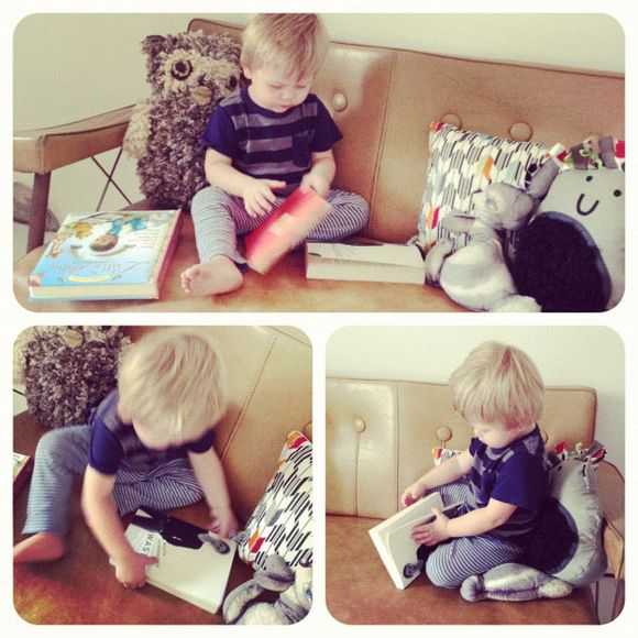 Diesel reading books in his room vintage furniture bench seat couch sofa