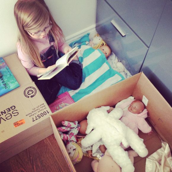 Feb lula reading to her baby dolls