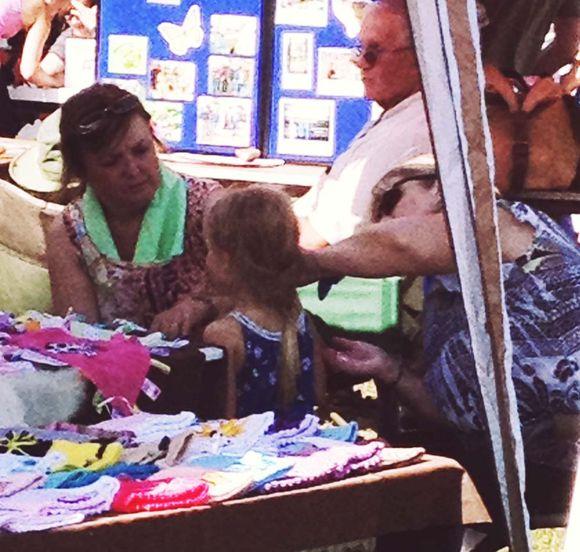 July butterfly festival lula getting sun screen