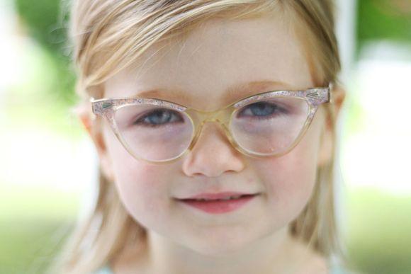 August pink eyeglasses serious
